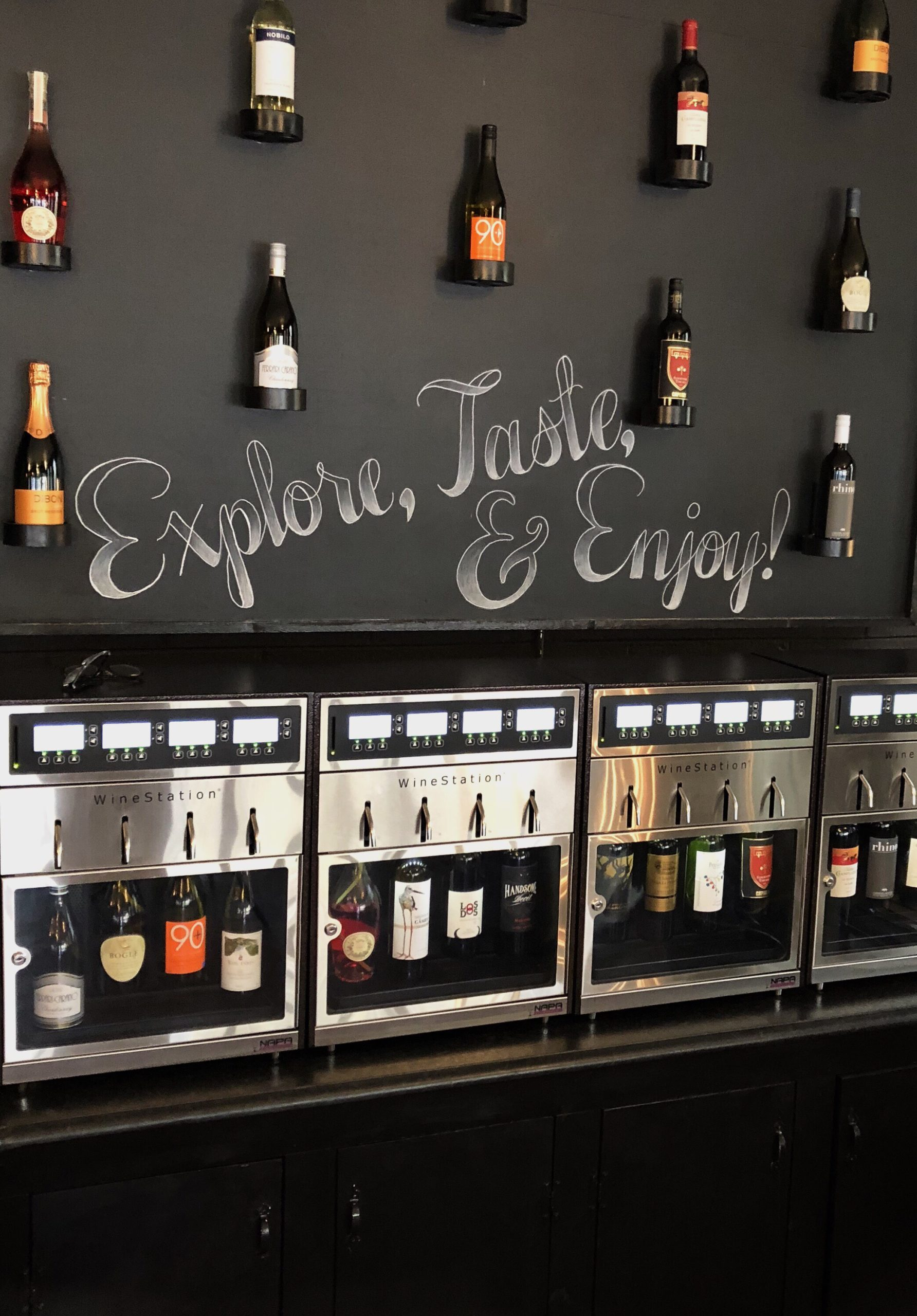 A wine station at Crema & vine, a self serve wine bar.
